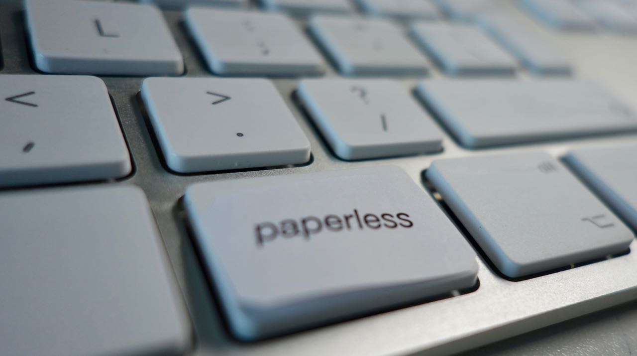 paperless medical records at Clinco represented by a keyboard key with the word 'paperless' on it.